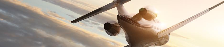 Plane flying into sunrise